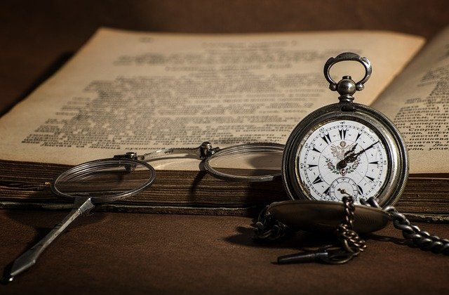 Old book, watch and specs: Living Legacy. Telling your story to leave behind.
